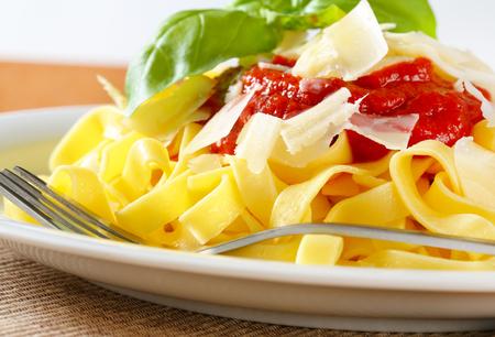 Tagliatelle pasta with tomato puree and Parmesan photo