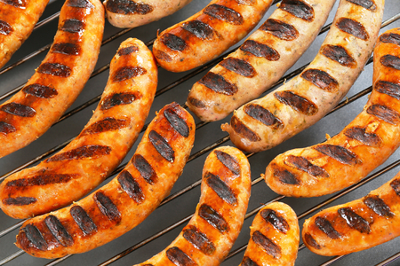 veal sausage: Grilled bratwursts on barbecue grid