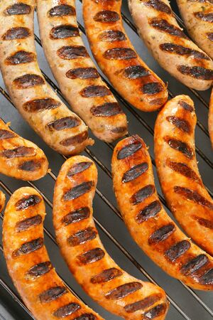 Grilled bratwursts on barbecue grid Stock Photo - 22893608