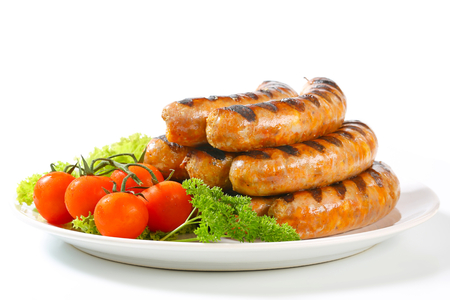 Pile of grilled German sausages photo