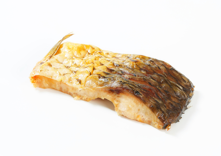 Oven-baked carp fillet - studio shot photo