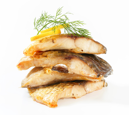 Oven-baked carp fillets - studio shot photo
