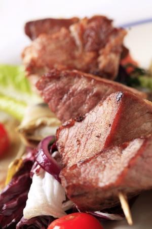 accompaniment: Pork shish kebab and vegetable accompaniment