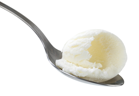 White ice cream on metal spoon photo