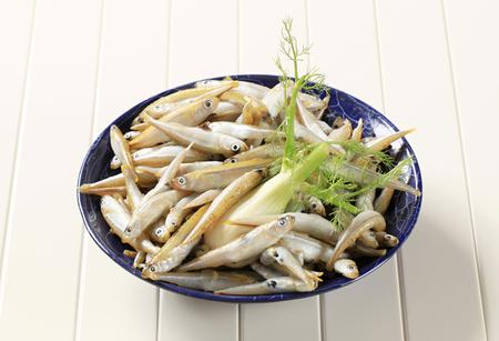 sprats: Bowl of fresh sprats with fennel