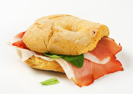 Ring-shaped bread roll (friselle) with slices of Schwarzwald ham photo