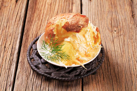 trivet: Baked potato with two kinds of cheese