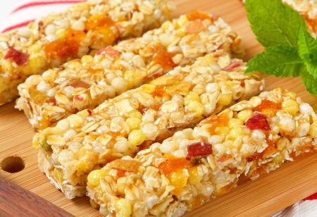 Cereal bars with pieces of dried apricot and apple Reklamní fotografie - 24309404