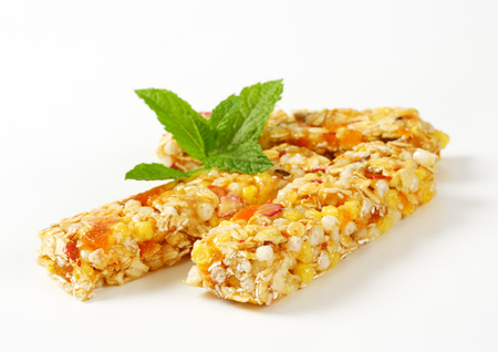 Cereal bars with pieces of dried apricot and apple photo