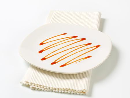 caramel sauce: Caramel sauce on a plate