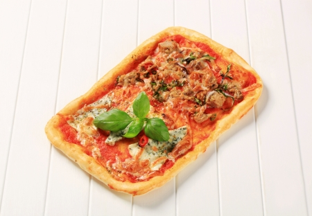 Rectangular pizza topped with blue cheese and tuna