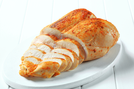 Chicken breast rubbed with garlic paste photo