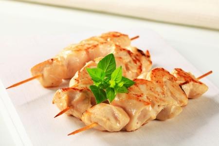 Chicken breast meat on wooden skewers photo