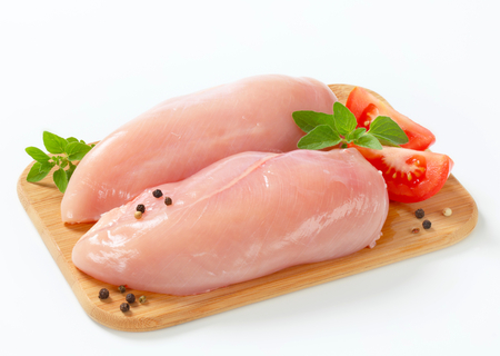 Raw skinless chicken breast fillets photo
