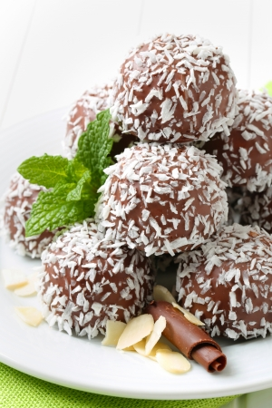 No-bake chocolate snowball cookies rolled in coconut Stock Photo