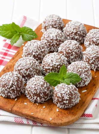 Chocolate snowball truffles rolled in coconut photo