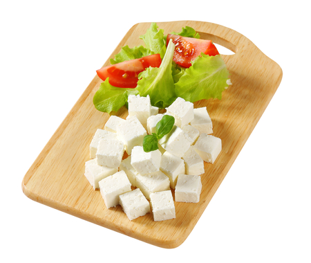 Cubes of feta cheese on a plate photo