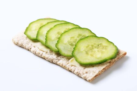 Crisp bread with slices of fresh cucumber photo