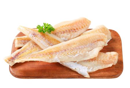 coalfish: Fresh fish fillets on cutting board Stock Photo