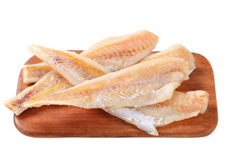 Fresh fish fillets on cutting board photo