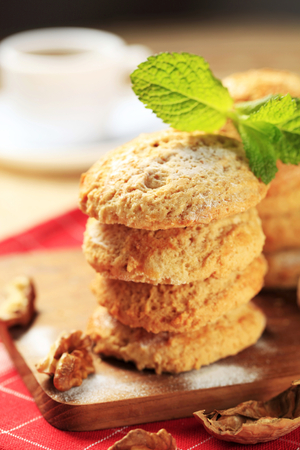 Crispy nut cookies on cutting board photo