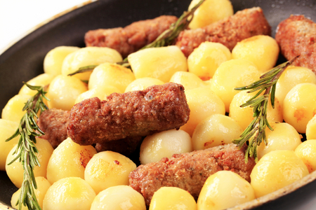 Pan-roasted minced meat kebabs and potatoes photo