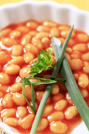 lima beans white beans: Macro shot of baked beans in a casserole dish Stock Photo