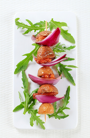 spanish onion: Pork and bacon skewer with potatoes and Spanish onion