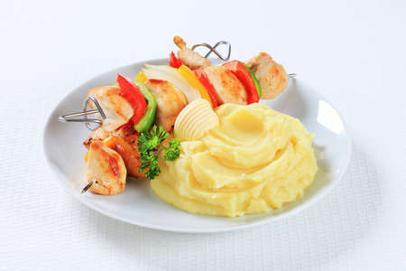 Chicken skewers served with mashed potato photo