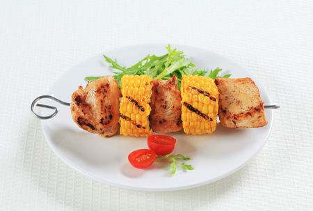 Grilled chicken and sweet corn on skewer  photo