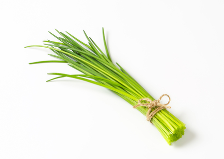 Bunch of fresh chives on white background