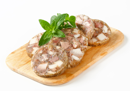 jelly head: Sliced head cheese on a cutting board Stock Photo