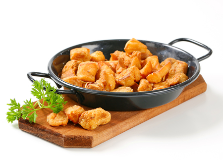 skillet: Crispy fried pork greaves in a skillet Stock Photo