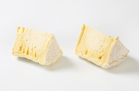 penicillium: Wedges of French white rind cheese Stock Photo