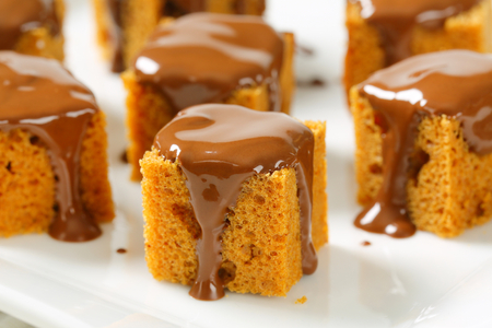 Bite-sized gingerbread squares with liquid chocolate photo