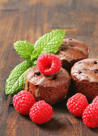 Mini chocolate cakes with raspberry filling Stock Photo