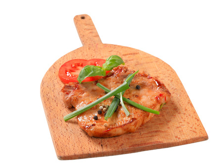 Spicy pork cutlet on cutting board photo
