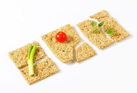 sesame cracker: Whole wheat crackers with sesame seeds and chopped herbs Stock Photo