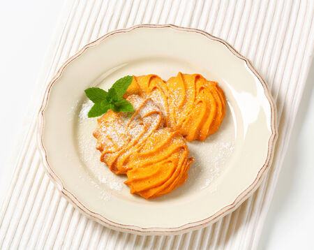 Spritz butter cookies on plate