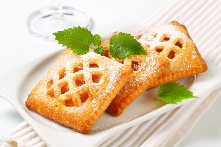 Little lattice-topped pies with apricot filling photo