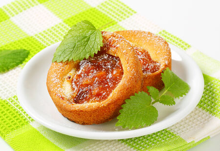 Small round cakes filled with apple puree photo