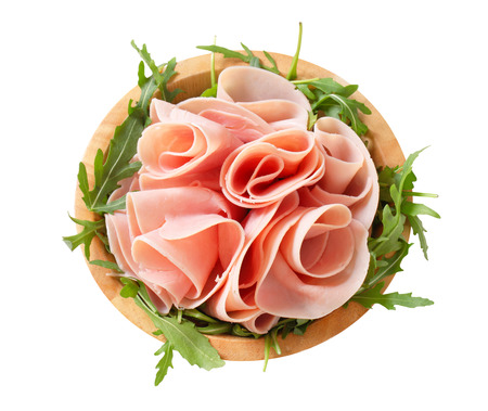 Sliced ham on nest of rocket salad photo