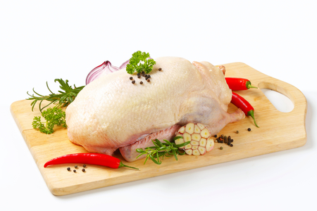 Raw duck and other ingredients on cutting board