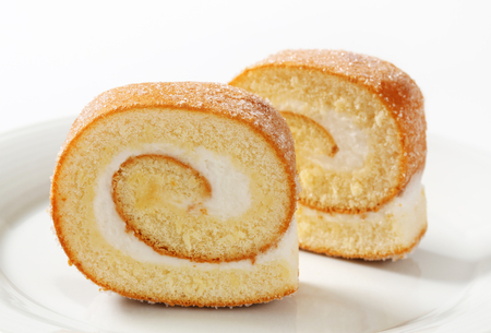 Sponge cake roll with cream filling photo