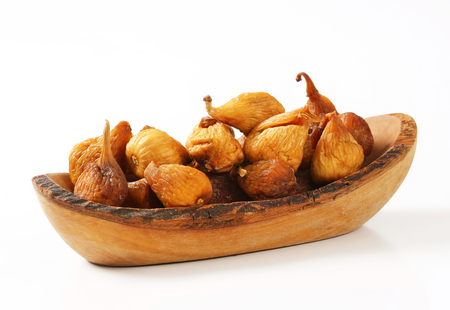 Dried figs in olive wood bowl photo