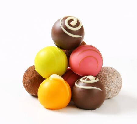 Assorted chocolate truffles and fruit ganache pralines photo