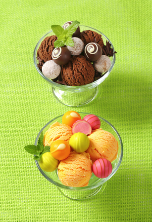 ganache: Ice cream coupes with chocolate truffles and fruit-flavored pralines Stock Photo
