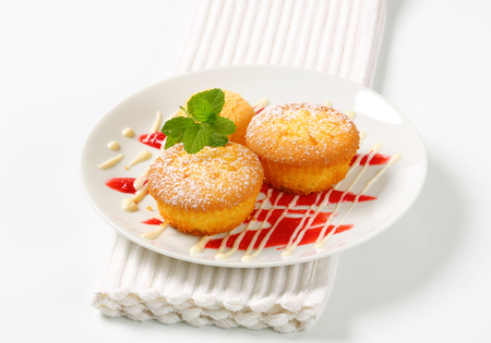 Custard filled muffins with scoop of ice cream photo