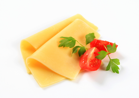 Thin slices of yellow cheese and tomato wedges
