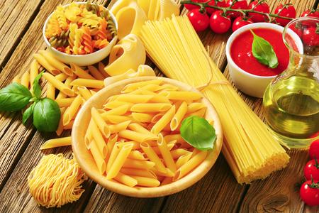 Assorted pasta, tomato passata and olive oil photo